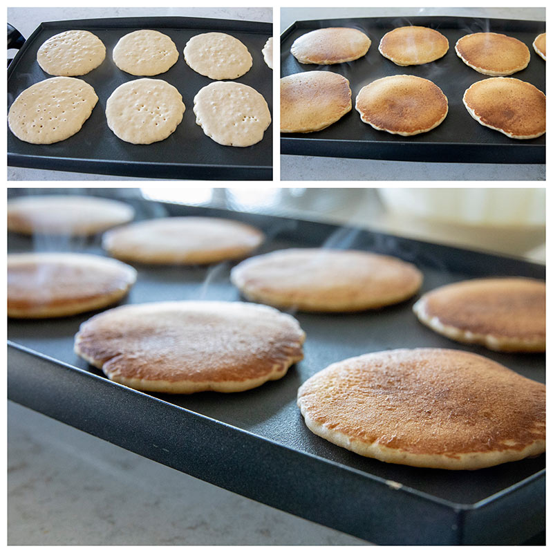 Sourdough pancakes cooking on an electric griddle