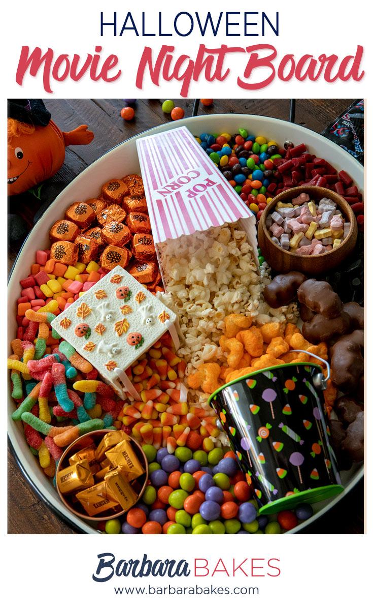 Halloween Movie Night Board in an oval tin