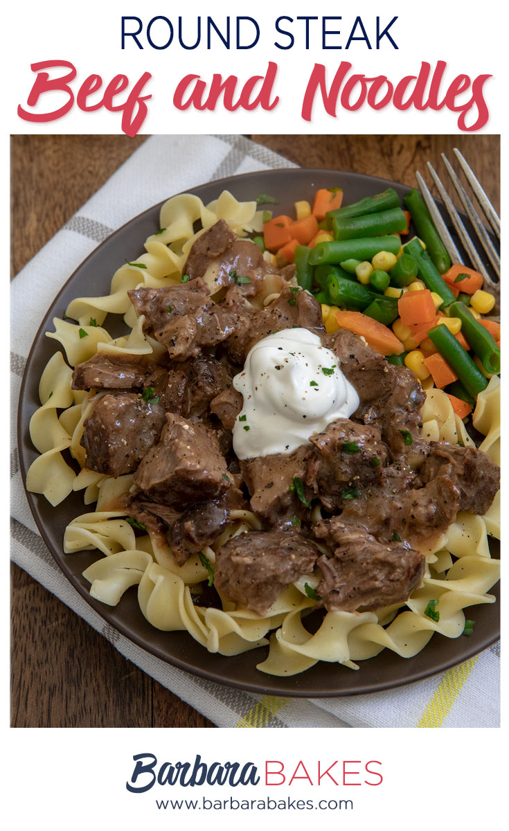 Round Steak Beef in Gravy on top of wide noodles topped with sour cream