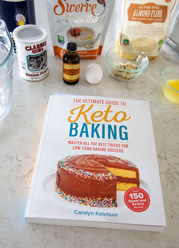Ingredients to make low carb almond biscotti and The Ultimate Keto Baking cookbook