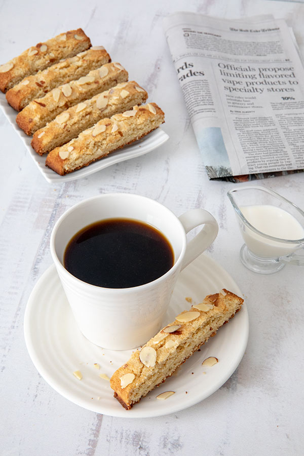 Low Carb Almond Biscotti on a plate with coffee