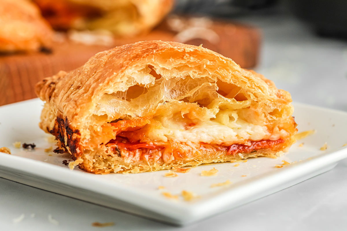 air fryer pizza pocket cut in half to show cheese, pepperoni and pizza sauce